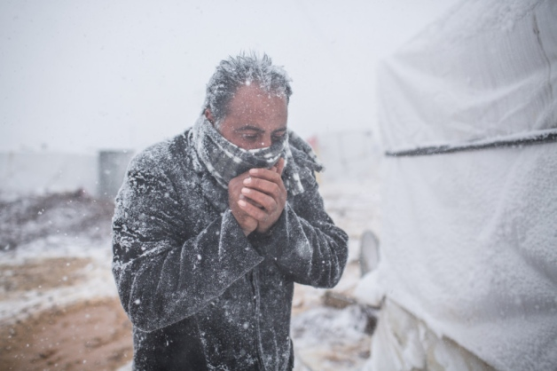 A freezing man at the Syrian refugee camp
